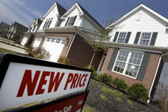 In a Tuesday,  March 20, 2012 photo, newly-constructed homes are seen for sale with a new price in Pepper Pike, Ohio. The Commerce Department says new-home sales fell 1.6 percent last month to a seasonally adjusted annual rate of 313,000 homes. Sales have fallen nearly 7 percent since December.  (AP Photo/Amy Sancetta) 03282012xBRIEFING